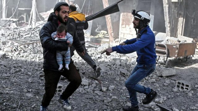 https://thegeopolity.com/wp-content/uploads/2018/04/A-man-carries-an-infant-injured-during-government-bombing-in-Hamouria-Eastern-Ghouta-region-on-19-February-2018-AFP-640x360.jpg