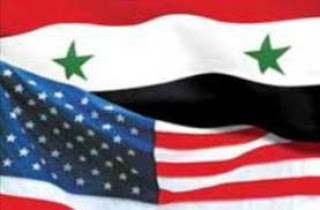 https://thegeopolity.com/wp-content/uploads/2019/11/syrian-american-flags.jpg