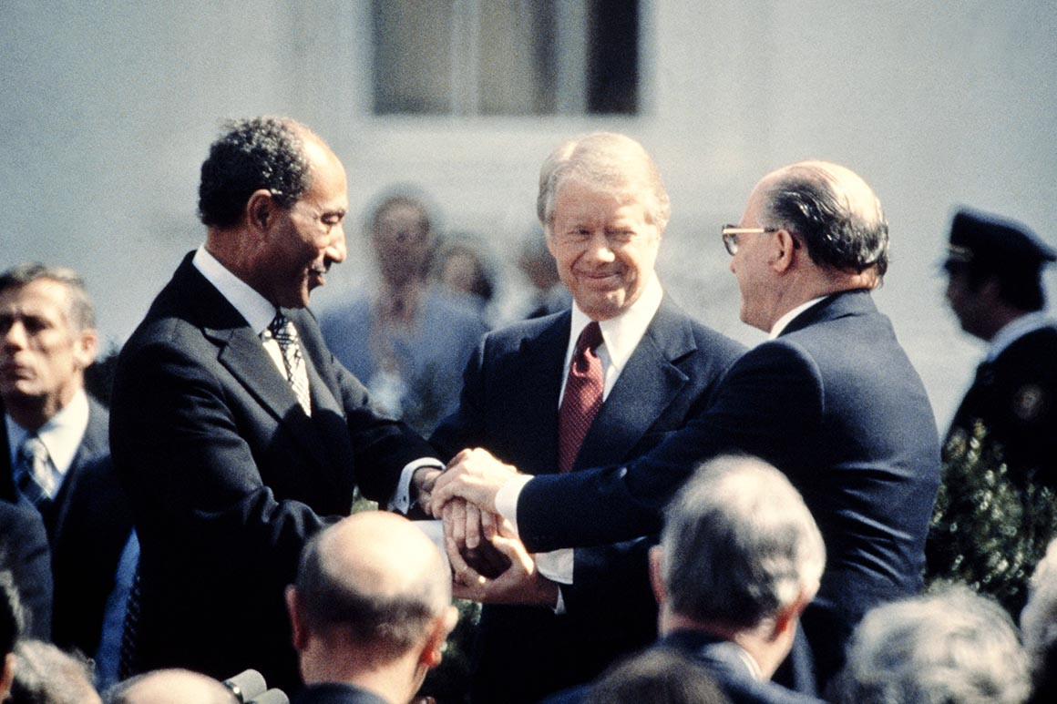 Egyptian President Anwar Sadat, US President Jimmy Carter, and Israeli Prime Minister Menachem Begin, on the north lawn of the White House in Washington, DC, on March 26, 1979, as they completed the signing of the peace treaty between Egypt and Israel